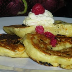 Banana-White Chocolate Pancakes Recipe - These banana pancakes have a delicious new twist! White chocolate chips give these pancakes an intense flavor rush spiced with cinnamon, ginger, and vanilla. Using a boxed pancake mix make these super easy to make, but so delicious people will be begging for the recipe!