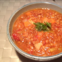 Hearty Lentil Soup II Recipe - This is a rich, satisfying vegetarian soup, wonderful for cold winter nights. Serve with crusty bread. For variety, you can also add some sliced vegetarian sausage or bacon substitute towards the end of cooking. Garnish with chopped fresh coriander OR parsley.