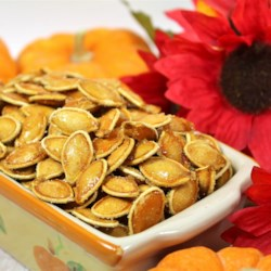 Honey Pumpkin Seeds Recipe - Pumpkin seeds are coated in plenty of honey and baked into a sweet treat to serve after carving pumpkins.