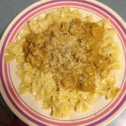 Pasta with Italian Sausage and Pumpkin Sauce Recipe - Tender campanelle (trumpet-shaped pasta) are served in a creamy sauce with Italian sausage and pumpkin for a main dish that's perfect for fall.