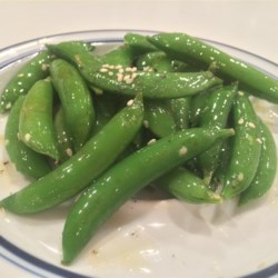 Sesame Snap Peas Recipe - Sesame and chili oils add rich flavor and a little kick to naturally sweet snap peas. This versatile side dish has an Asian feel to it, so goes well with Asian dishes.  Scale this recipe up or down easily for larger or smaller crowds.