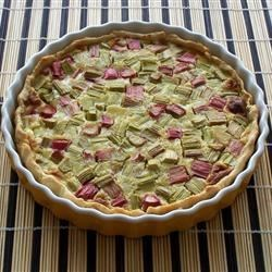 Rhubarb Custard Pie IV Recipe -  Fresh rhubarb is cut into small pieces and piled into a prepared crust. A creamy custard filling is stirred up with eggs, a bit of milk, flour, sugar and nutmeg, and then it 's poured over the rhubarb. The pie is slipped into the oven for an hour until the custard is set. Cool it slightly before serving.