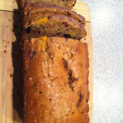 Festive Fruitcake Recipe - This is a large recipe that is rich and dark.  Make a few weeks ahead of time. The walnuts can be chopped or left whole.