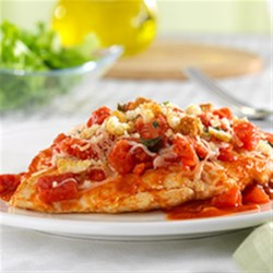 Hunts(R) Bruschetta Chicken Skillet Recipe - Chicken breast with diced tomatoes, cheese and basil cooked in tomato sauce, then topped with croutons just before serving for the flavor of bruschetta.