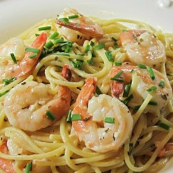Happy Shrimp Recipe - This creamy, spicy shrimp dish can be served alone with crusty bread or over angel hair pasta.