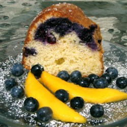 Blueberry Cream Cheese Pound Cake I Recipe - Blueberries and cream cheese are mixed into a yellow cake mix and baked in a Bundt pan.
