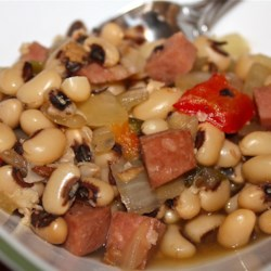Slow Cooker Spicy Black-Eyed Peas Recipe and Video - Black-eyed peas grab some heat and spice from jalapeno peppers and cumin in this flavorful slow cooker preparation that also includes diced ham, bacon, bell peppers, onion, and garlic.