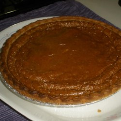 Tofu Pumpkin Pie Recipe - Silken tofu replaces both the eggs and dairy in this traditional pie with an untraditional twist.
