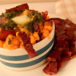 Basil Pesto and Bacon Mashed Sweet Potatoes Recipe - Mashed sweet potatoes get a different twist of flavor with homemade almond pesto and crisp bacon.