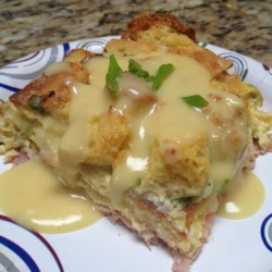 Eggs Benedict Casserole Recipe - Enjoy the flavors of eggs Benedict in an easy make-ahead breakfast casserole made with Canadian bacon or ham, English muffins, and hollandaise sauce.