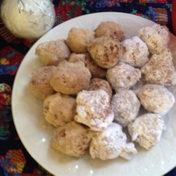 Crispy Cornmeal Drop Doughnuts Recipe - An inventive doughnut drop something like a sweet hush puppy with the addition of self-rising cornmeal. Roll in cinnamon and sugar, or eat them plain - they're delicious either way.