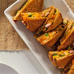 Broccoli Ham Grilled Cheese Sandwich Recipe - This hearty grilled sandwich is filled with two kinds of grated cheese, chopped cooked broccoli, and ham.