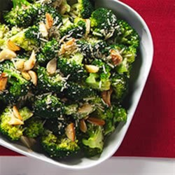 Garlic Roasted Broccoli with Parmesan Cheese Recipe - Broccoli is roasted with garlic and olive oil, then tossed with lemon juice and shaved parmesan cheese.