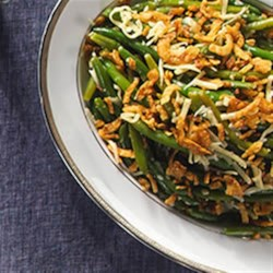 Green Bean Cheddar Casserole Recipe - This classic casserole with green beans, French-fried onions, and mushroom soup is even better with sharp Cheddar cheese.