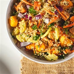 Quinoa Salad with Winter Veggies and Buffalo Chicken Sausage Recipe - This hearty grain salad with browned sausage, carrots, and butternut squash is tossed with quinoa for a delicious all-in-one meal.