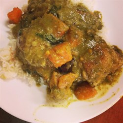 Green Coconut Chicken Recipe and Video - The combination of chicken legs braised with sweet coconut milk, spicy jalapeno peppers, and red curry powder create a flavorful green curry-style dish.