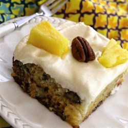 Pineapple and Pecan Cake Recipe - Sweet pineapple cake gets an extra crunch thanks to the toasted pecans in the batter. Frost with homemade cream cheese icing!