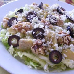 Walnut Blue Cheese Artichoke Salad Recipe - All you need for this quick and delicious salad is lettuce, Gorgonzola cheese, artichokes, walnuts, and olives.
