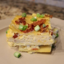 Perogie Casserole Recipe - Lasagna noodles with piles of potatoes mixed with melted Cheddar, cottage cheese, bacon and onions.
