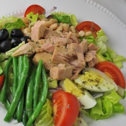 Nicoise-Style Tuna Salad With White Beans & Olives Recipe - For my nicoise-style tuna salad, just open three cans: one each of tuna, white beans and sliced olives. Toss these ingredients with slivered red onion, olive oil and lemon juice. Take time, if you like, to boil eggs, or pick them up at the grocery salad bar. Serve the salad with steamed green beans. For an even simpler version, add a little chopped parsley to the salad for color and serve it with salted tomato slices.
