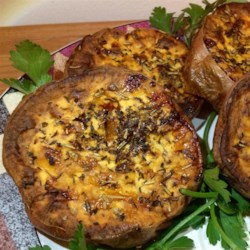 Thyme Roasted Sweet Potatoes Recipe - Roasted sweet potatoes coated in fresh thyme leaves and garlic are a crowd-pleasing side dish for dinner parties or Thanksgiving dinner.