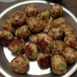 Bri's Buffalo Chicken Meatballs Recipe - Serve these yummy chicken meatball appetizers with a spicy ranch sauce at your next gathering.