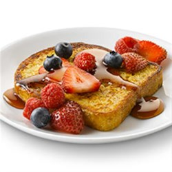 French Toast with Mixed Berries with Truvia(R) Natural Sweetener Recipe - A basic breakfast staple with a lower-calorie spin. This French toast with mixed berries recipe contains 13% fewer calories and 50% less sugar than the full-sugar version.