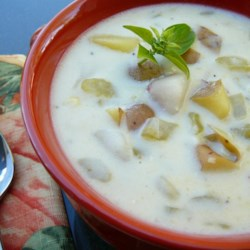 Cheesy Potato and Corn Chowder Recipe - Country-style milk gravy from a mix is added to vegetables simmered in chicken broth in this soup with Mexican-style processed cheese and green chiles.