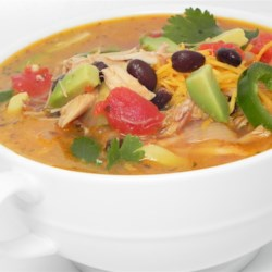 Southwestern Turkey Soup Recipe - Shredded leftover turkey is cooked with tomatoes and green chiles, spiced with cayenne and cumin and finished off with fresh avocado and dried cilantro for a zesty, unusual soup.