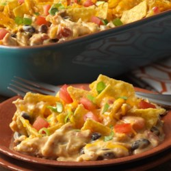 Chicken Taco Casserole Recipe - All of your favorite taco fixings can be found in this crowd-pleasing casserole. Plus, it uses convenience products like canned soup and veggies, cooked chicken and taco seasoning mix that make it a snap to prepare. It's loaded with fantastic flavor and on the table in less than an hour!