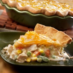 Ultimate Chicken Pot Pie Recipe - Using convenience products like canned soup, cooked chicken, frozen veggies and refrigerated pie crusts make this comfort food classic a cinch to prepare. It's chock full of flavor and ready in just 50 minutes.