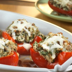 Easy Spinach Stuffed Peppers Recipe - Fresh peppers are stuffed with a delicious combination featuring spinach, herb-seasoned stuffing, cream of mushroom soup and Parmesan cheese. Topped with mozzarella and baked to perfection, these stuffed peppers are simply irresistible!