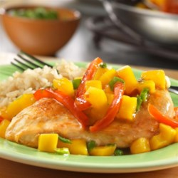 Spicy Glazed Mango Chicken Recipe - Sautéed, boneless chicken breasts are paired with flavorful rice and a spicy mango mixture that will have your taste buds tingling for more! This one is definitely a keeper.
