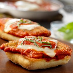 Open Faced Chicken Parmesan Sandwiches with Creamy Vodka Sauce Recipe - These fabulous sandwiches feature breaded chicken cutlets topped with a delicious creamy vodka sauce and melted mozzarella. Perfect for busy weeknights, they're ready in just 25 minutes!