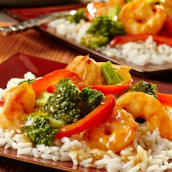 Hot and Sour Shrimp and Broccoli Recipe - This one-skillet dish is simple to prepare but chock full of flavor. Shrimp, broccoli and red pepper are simmered in a savory broth and served over a bed of rice. Skip the take-out--this is so much better!