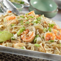 Shrimp Pad Thai Style Recipe - This Asian-inspired dish features sautéed shrimp, red pepper, onion and tofu paired with a savory broth, rice noodles and fresh bean sprouts. The flavors blend together perfectly for a main meal that's simply amazing!