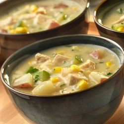 Hearty Chicken and Vegetable Chowder Recipe - This creamy, hearty chowder features chicken paired with a flavorful combination of zucchini, corn, potatoes and cream of celery soup. Cozy up to a bowl for a satisfying and delicious soup!