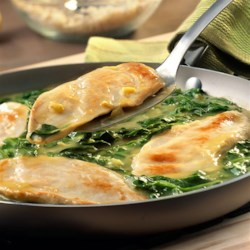 Lemon Chicken Scallopini with Spinach Recipe - This Italian-inspired skillet dish features tender chicken breasts sauteed in a brightly flavored lemon sauce with fresh baby spinach. Plus, this restaurant-style meal is on the table in just 25 minutes!