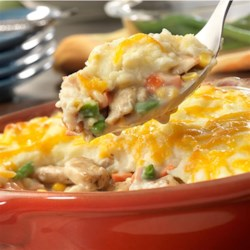 Easy Chicken Shepherd's Pie Recipe - Here's a delicious twist on pot pie your family is sure to love! Chicken, veggies, cream of mushroom soup and instant mashed potato flakes transform into a mouth-watering dish that's irresistible!