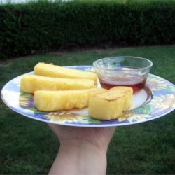 Fried Cornmeal Mush Recipe - Cooked cornmeal is chilled overnight and then fried until golden brown.