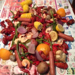Louisiana Crawfish Boil Recipe - Feed a crowd with a Cajun-style crawfish boil prepared outside over propane heat or inside atop the stove. Use your largest stockpot and boil artichokes, potatoes, corn, onions, mushrooms, green beans, and sausage with crawfish in a spicy broth brimming with traditional seasonings.