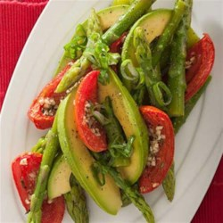 Asparagus, Avocado and Slow-Roasted Tomato Salad Recipe - This colorful, composed salad with asparagus, roasted tomatoes and avocado slices is drizzled with a sherry vinaigrette.