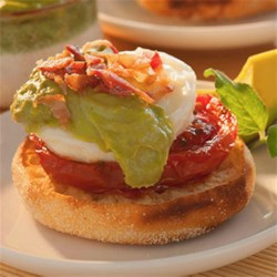 Avocado Sauce Eggs Benedict Recipe - Lighter than hollandaise but just as rich and creamy, this flavorful avocado sauce makes delicious eggs benedict with roasted tomatoes and crumbled bacon.