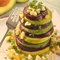 Roasted Beet, Avocado and Granny Smith Apples Tower Recipe - Slices of roasted beets, avocado, and tart apples are topped with crumbled goat cheese, parsley and pine nuts and drizzled with olive oil.