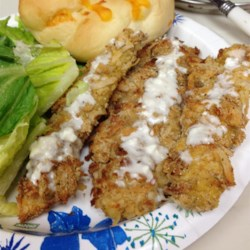 Coconut Chicken Recipe - Crunchy baked strips of chicken breast coated in coconut crumbs are served with a creamy coconut-mayonnaise sauce. The Chinese buffet favorite is easy to make at home without deep frying.