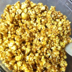 Protein Popcorn Recipe - Popcorn is sweetened with corn syrup, honey, sugar, peanut butter, and vanilla in this recipe.