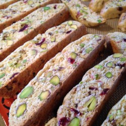 Cranberry Pistachio Biscotti Recipe and Video - The red and green make a very pretty cookie. You may use other nuts instead of pistachios, if you prefer.