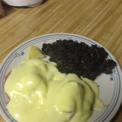Southern Hollandaise Sauce Recipe - This simple hollandaise sauce has an extra kick - just a touch of cayenne pepper. Serve with cooked vegetables or fish.