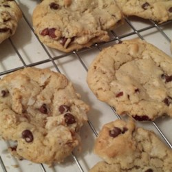 Dishpan Cookies III Recipe - These cookies have a little of everything in them. Oatmeal, cornflakes and chocolate chips add character to these fine cookies.