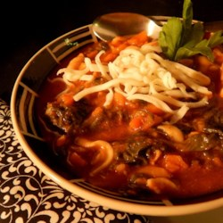 Chicken Vegetable Soup Recipe - This is a minestrone-like soup with frozen carrot slices, bow-tie pasta, chopped spinach and chicken simmered in a tomato and chicken broth.